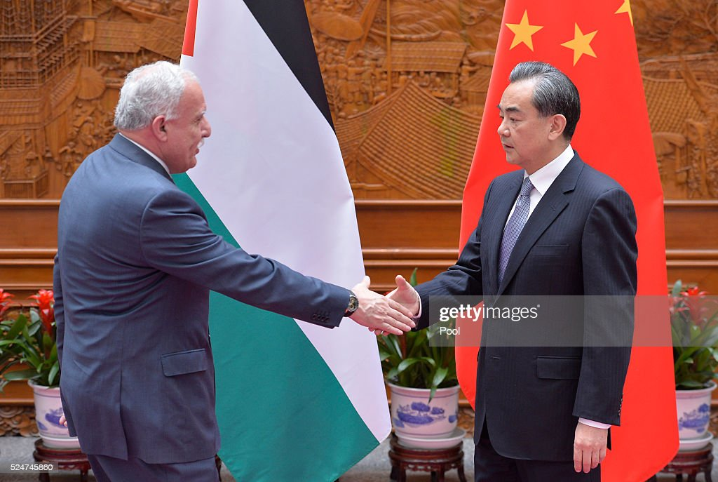 Palestinian Foreign Minister <a gi-track='captionPersonalityLinkClicked' href=/galleries/search?phrase=Riyad+al-Maliki&family=editorial&specificpeople=4534561 ng-click='$event.stopPropagation()'>Riyad al-Maliki</a> (L) shakes hands with Chinese Foreign Minister <a gi-track='captionPersonalityLinkClicked' href=/galleries/search?phrase=Wang+Yi+-+Politician&family=editorial&specificpeople=13620429 ng-click='$event.stopPropagation()'>Wang Yi</a> (R) before a meeting at the Ministry of Foreign Affairs April 27, 2016 in Beijing, China.