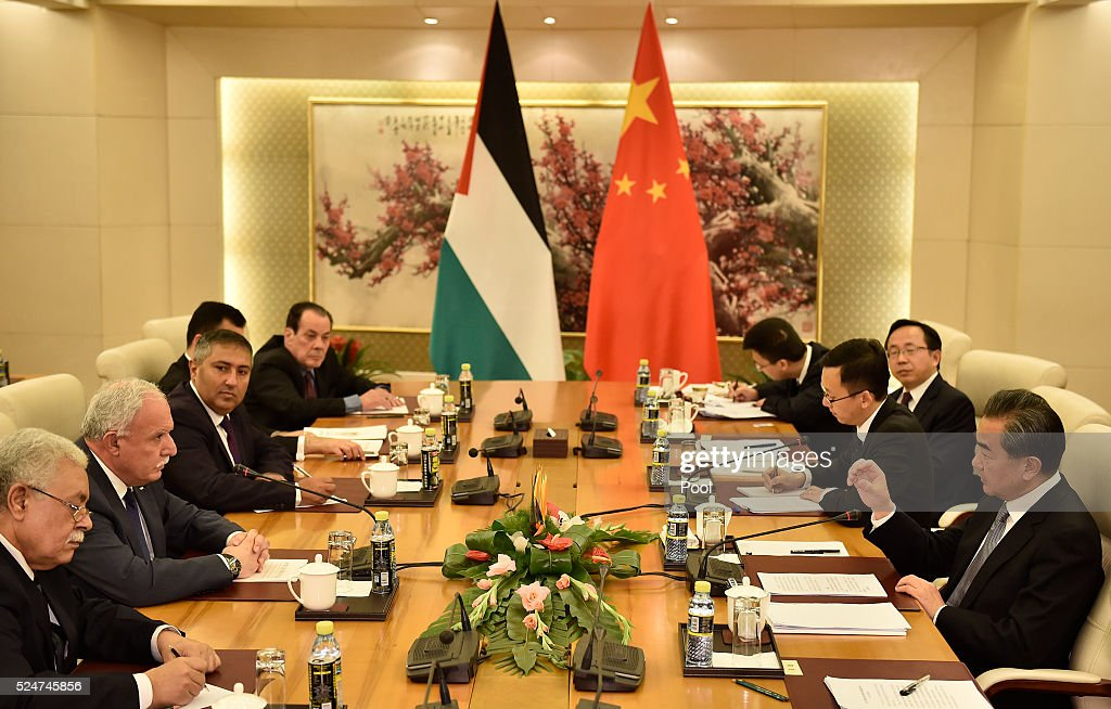 Palestinian Foreign Minister <a gi-track='captionPersonalityLinkClicked' href=/galleries/search?phrase=Riyad+al-Maliki&family=editorial&specificpeople=4534561 ng-click='$event.stopPropagation()'>Riyad al-Maliki</a> (2nd L) talks with Chinese Foreign Minister <a gi-track='captionPersonalityLinkClicked' href=/galleries/search?phrase=Wang+Yi+-+Politician&family=editorial&specificpeople=13620429 ng-click='$event.stopPropagation()'>Wang Yi</a> (R) during a meeting at the Ministry of Foreign Affairs April 27, 2016 in Beijing, China.