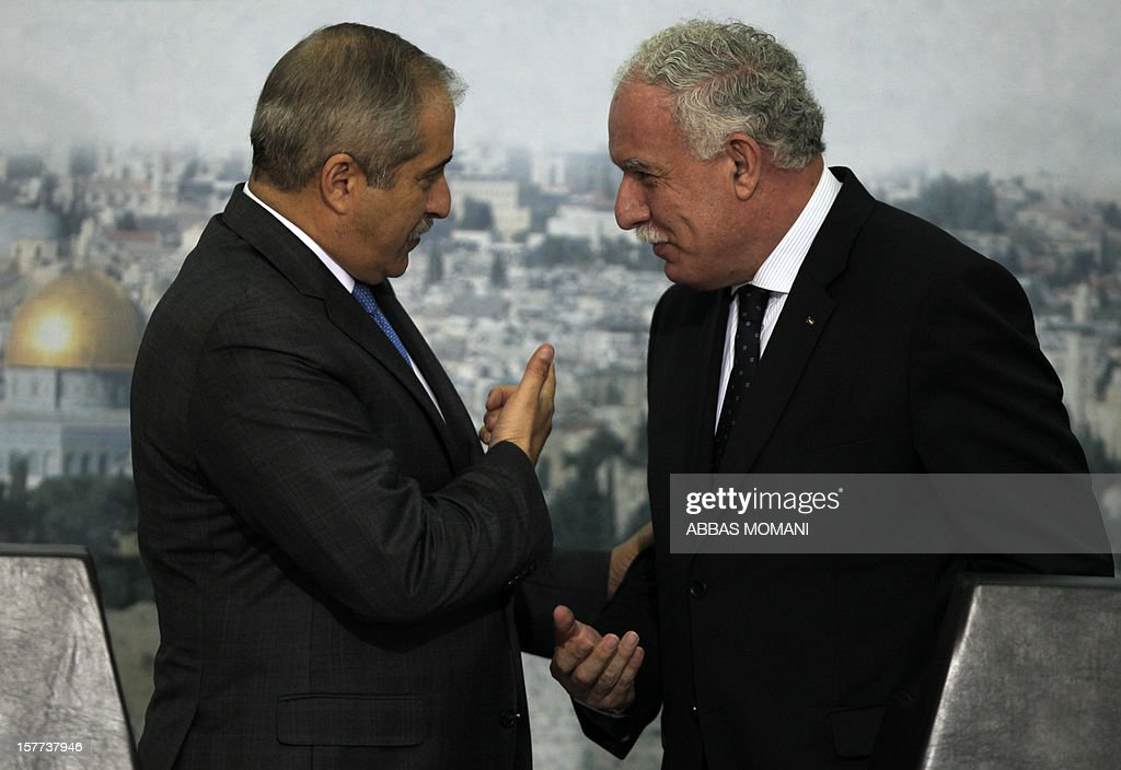 Palestinian foreign minister Riyad al-Malki (R) shakes hands with his Jordanian counterpart Nasser Judeh during a joint press conference in the West Bank city of Ramallah on December 6, 2012. Judeh is accompanying Jordanian King Abdullah II on the first visit by a top foreign leader since the Palestinians gained upgraded United Nations status.