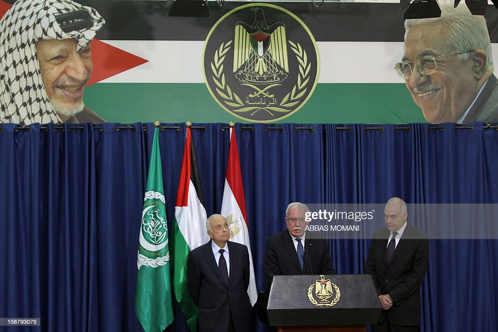 Palestinian Foreign Minister Riyad al-Malki (C) speaks as Arab League Secretary General Nabil al-Arabi (L) and Egypt's Foreign Minister Mohamed Kamal Amr (R) listen on during a press conference following their arrival in the West Bank city of Ramallah for a meeting with Palestinian president Mahmud Abbas on December 29, 2012.