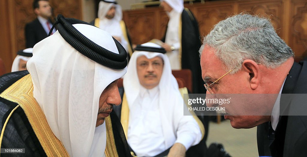 Palestinian foreign minister Riyad al-Malki (R) speaks with his Qatari counterpart Sheikh Hamad bin Jassem bin Jabr al-Thani during an emergency meeting at the Arab League headquarters in Cairo on June 2, 2010 in a bid to come up with a unified response to an Israeli deadly raid on an aid convoy bound for the Gaza Strip.