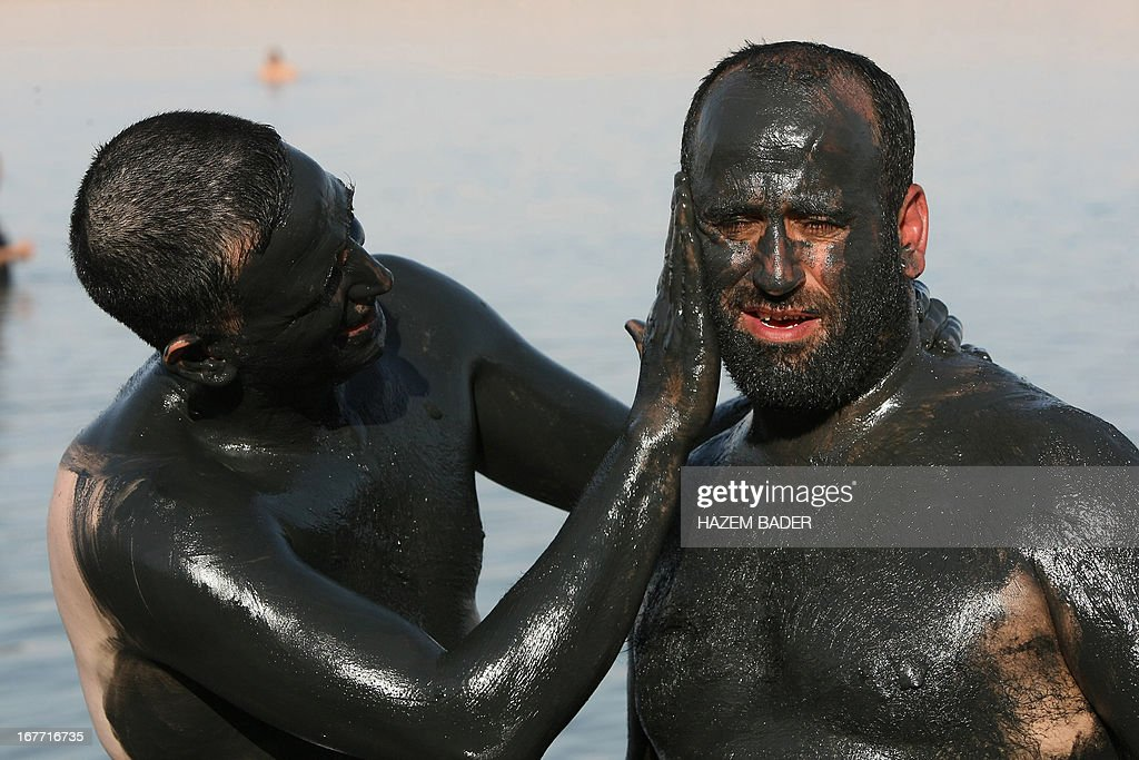 Palestinian friends apply mud to each other at the Dead Sea at the Biankini beach located along the northern shore near the city of Jericho, in the Israeli occupied West Bank, on April 28, 2013. Palestinians can access this area of the Dead Sea without an Israeli government permit.