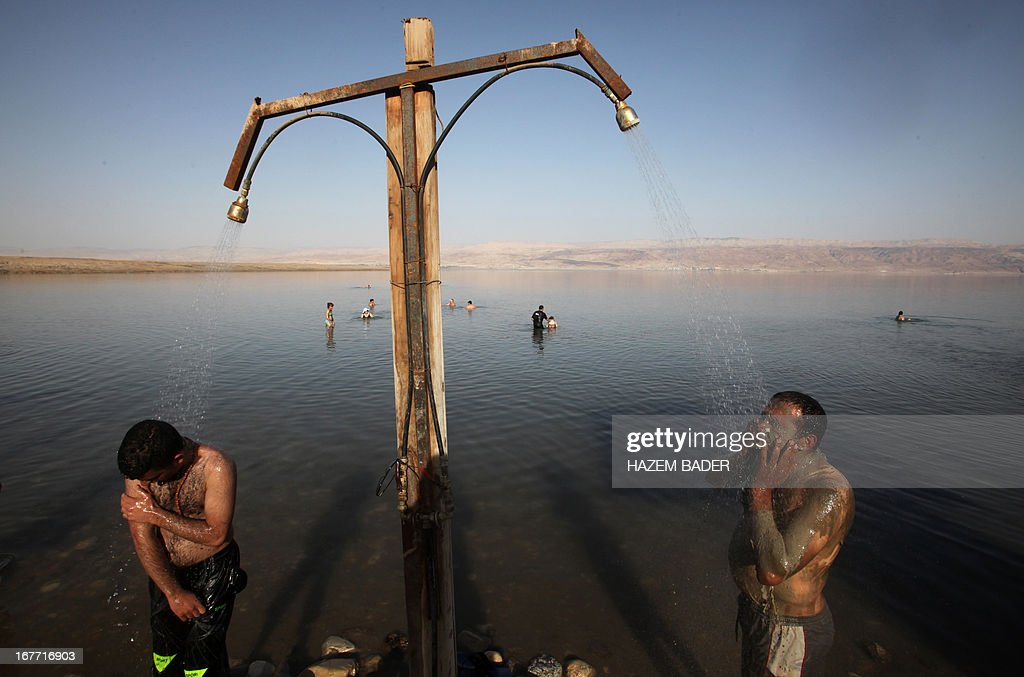 Palestinian friends enjoy the Dead Sea at the Biankini beach located along the northern shore near the city of Jericho, in the Israeli occupied West Bank, on April 28, 2013. Palestinians can access this area of the Dead Sea without an Israeli government permit.