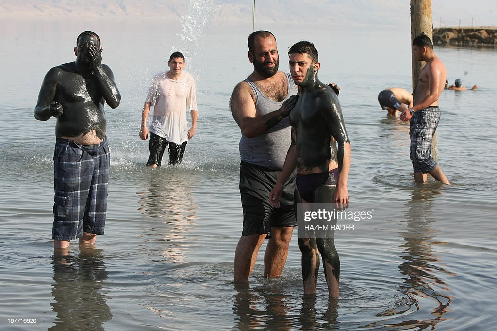 Palestinian friends enjoy the Dead Sea at the Biankini beach located along the northern shore near the city of Jericho, in the Israeli occupied West Bank, on April 28, 2013. Palestinians can access this area of the Dead Sea without an Israeli government permit. AFP PHOTO/HAZEM BADER
