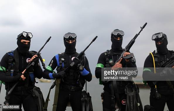 Palestinian Frogmen of the Ezzedine alQassam Brigades Hamas's armed wing pose in wetsuits as they take part in a military parade marking the 27th...