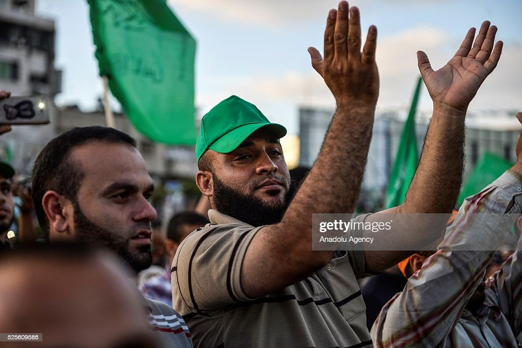 A Palestinian gestures as Hamas Political Bureau Vice President Ismail Haniyeh speaks during a festival in Gaza City, Gaza on April 28, 2016.