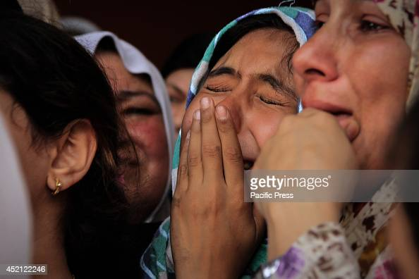 Palestinian girl crying during the funeral of her brother who was killed during the raid of the Israeli Air Force in central Gaza City in the sixth...