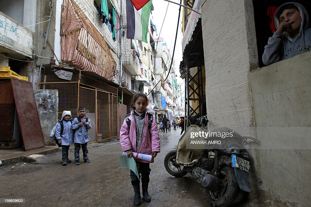 Palestinian girl (C) from the Syrian refugee camp of Yarmuk stands in a street at the Shatila refugee camp in the Lebanese capital Beirut on December 19, 2012. According to the UN Relief and Works Agency, some 10,000 Palestinian refugees have fled the Syrian conflict for neighbouring Lebanon.