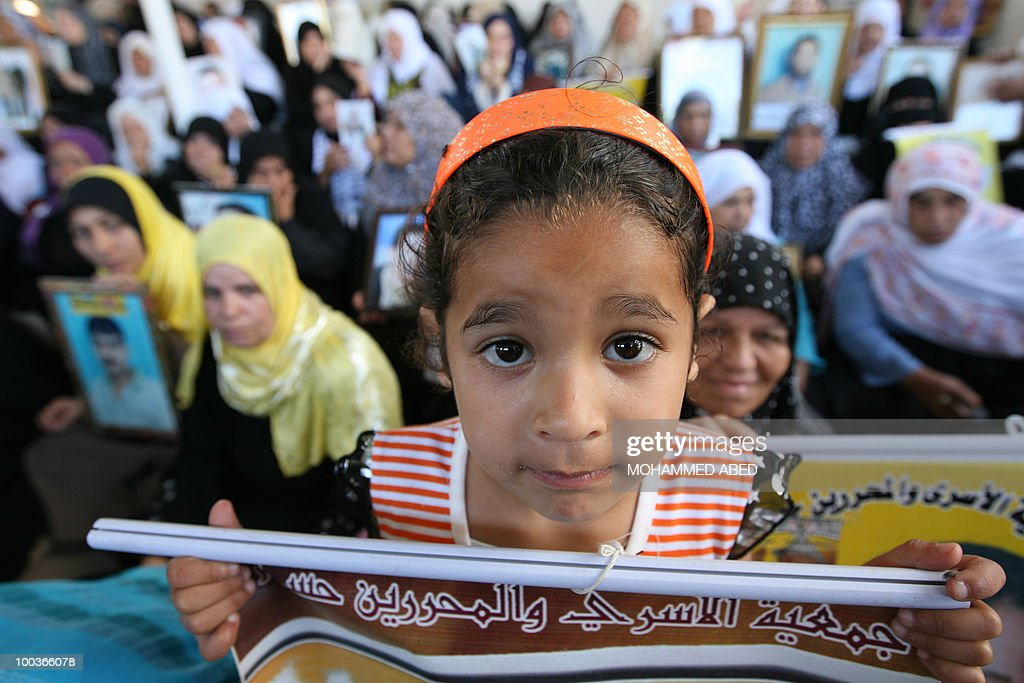 A Palestinian girl joins women taking part in a protest in Gaza City on May 24, 2010 to demand the release of Palestinian prisoners held in Israeli jails. An Israeli ministerial committee approved on May 23 a draft bill seeking to toughen the conditions under which Hamas prisoners are held in response to the stalemate over kidnapped soldier Gilad Shalit.
