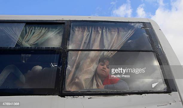 Palestinian girl look out of a bus window as she leaves Gaza at the Rafah crossing between Egypt and Rafah in southern Gaza Strip The Egyptian...