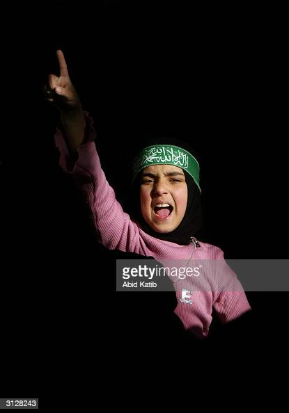 Palestinian girl shouts slogans against Israel as the new leader of the Palestinian militant group Hamas AbdelAziz alRantissi speaks during his visit...