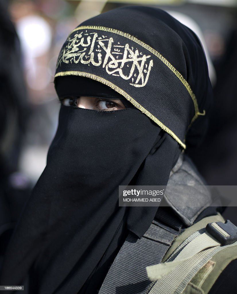 A Palestinian girl takes part in a rally by the Islamic Jihad to mark the anniversary of the movement's foundation in Gaza City, on November 1, 2013.
