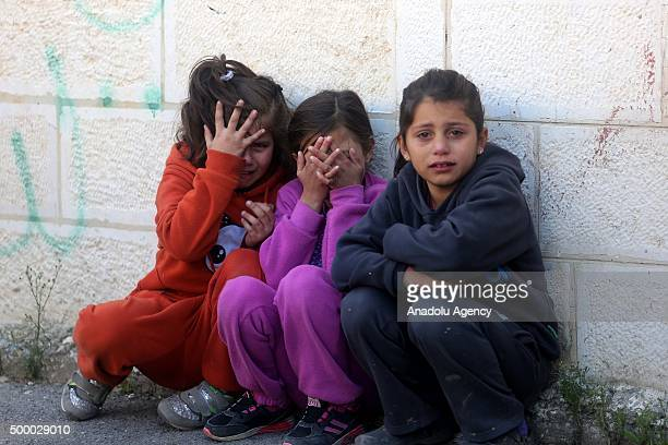 Palestinian girls mourn during the funeral of Abed AlRahman AlBarghouthi in the Aboud village of Ramallah West Bank on December 05 2015 A Palestinian...