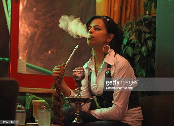 Palestinian girls smoke shisha pipes and drink coffee in Stars and Bucks coffee shop on August 24 2011 in Ramallah West Bank Palestinian President...