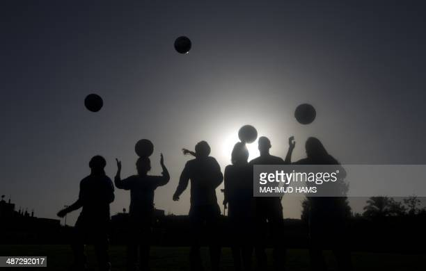 Palestinian girls take part in a training session at the Beit Lahia football club in the northern Gaza strip on April 28 2014 as part of an...