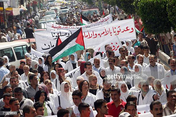 Palestinian government employees and their families demonstrate on the seventh day of a general strike in the West Bank town of Jenin 09 September...