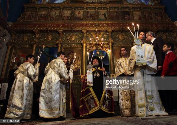Palestinian Greek Orthodox Christians attend Christmas mass at the Orthodox Saint Porfirios church in Gaza City on January 7 2014 The Orthodox Church...