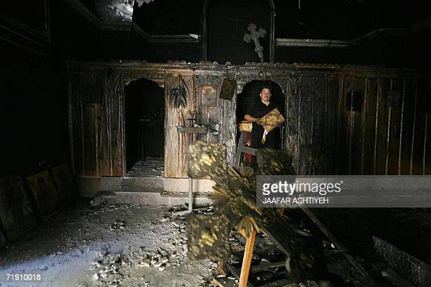 Palestinian Greek Orthodox worshipper rescues items form his badly damaged church in the northern West Bank town of Tulkarem 17 September 2006 The...