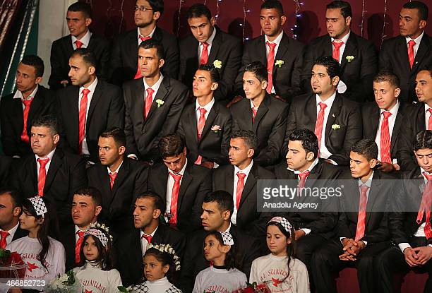 Palestinian grooms are seen during a collective wedding ceremony in Gaza City on February 4 2014