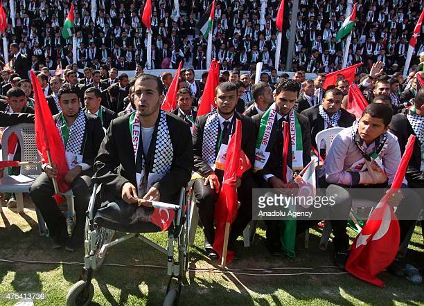 Palestinian grooms attend a mass wedding ceremony at the Yarmouk Stadium in Gaza on May 31 2015 Two thousand couples got married in the ceremony...