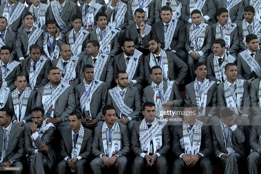 Palestinian grooms take part in a mass wedding ceremony in Rafah, southern Gaza Strip, on December 19, 2012. Some 436 couples in need participated to the mass wedding organized by the National Islamic Committee in the Gaza Strip and other financial donations.