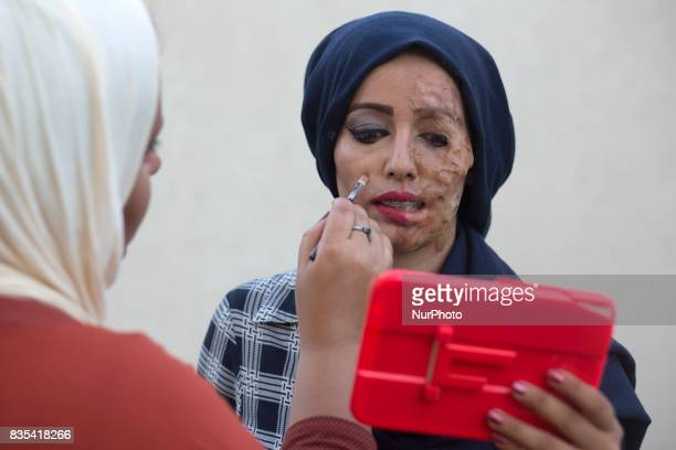 A Palestinian group of youth campaigning for cancer patients Gada Bin Said Naherl Aldreemly and artist Mariam Salah made a piece of art encouraging...