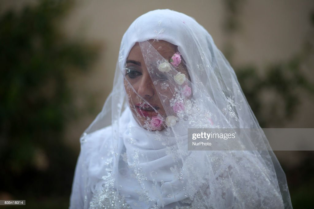 A Palestinian group of youth campaigning for cancer patients. Gada Bin Said, Naherl Aldreemly and artist Mariam Salah made a piece of art encouraging people to support cancer patients For marriage in Gaza City, Aug. 18, 2017. . Mariam Salah, a Palestinian artist, painted on one side of thecface and planted flowers on the other side. Gada Bin Said put on a wedding gown with cancer symbole. Throught there art, they support cancer patient as well as a hastage named (I am gonna live it). They aim to help cancer patients all over Gaza Strip