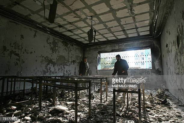 Palestinian guard inspects a destroyed classroom in the Islamic University a bastion of the rulin Hamas party in Gaza City 02 February 2007 The guard...