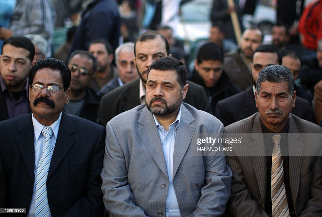 Palestinian Hamas leader in Lebanon, Osama Hamdan (C) attends a protest calling for the release of Palestinian prisoners from Israeli jails outside the International Red Cross offices in Gaza City on January 21, 2013.
