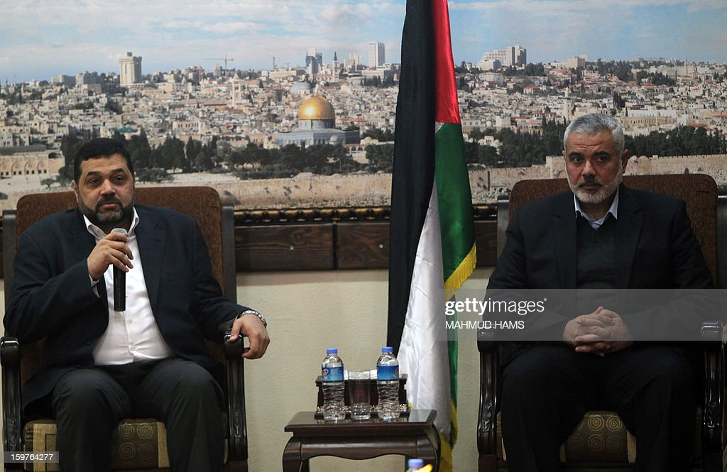 Palestinian Hamas leader in Lebanon, Osama Hamdan (L), speaks during his meeting with Gaza's Hamas prime minister Ismail Haniya upon the former's visit to Gaza City on January 20, 2013. AFP PHOTO / MAHMUD HAMS