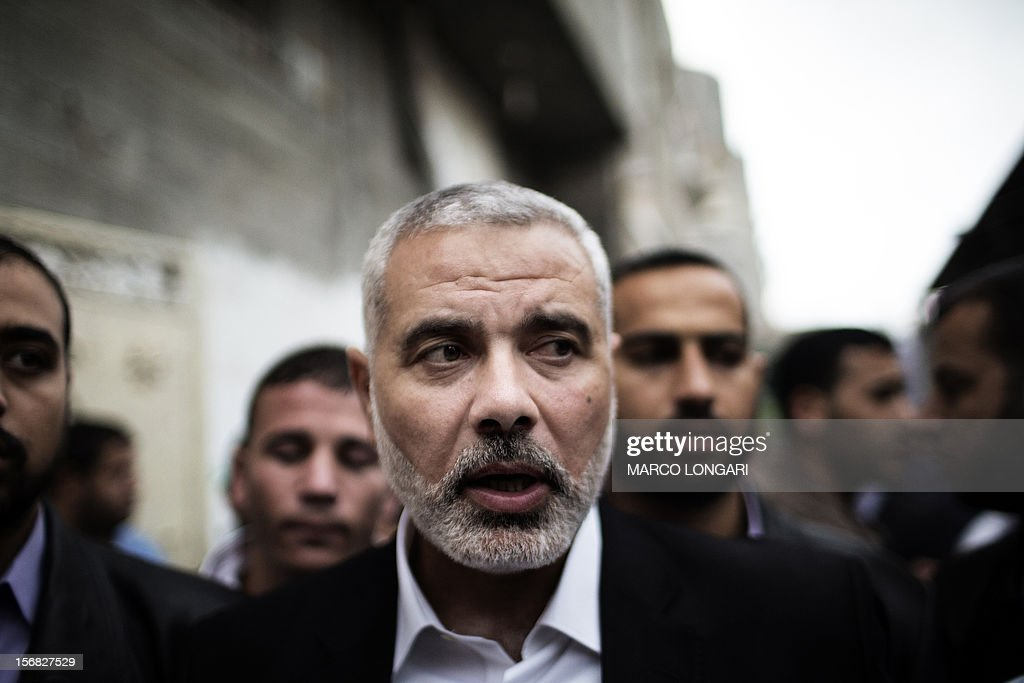 Palestinian Hamas leader in the Gaza Strip Ismail Haniya (C) leaves a condolences ceremony for Ahmed Jaabari, the late leader of the Hamas armed wing, the Ezzedine al-Qassam Brigades, in Gaza City on November 22, 2012. Jaabari was killed when his car was hit by an Israeli airstrike in Gaza City on November 14.