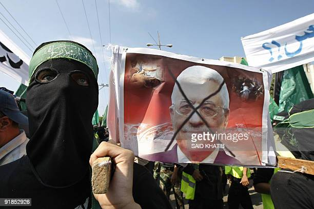 Palestinian Hamas members carry a mock coffin of Palestinian president Mahmud Abbas during a rally in the alNuseirat refugee camp in central Gaza...