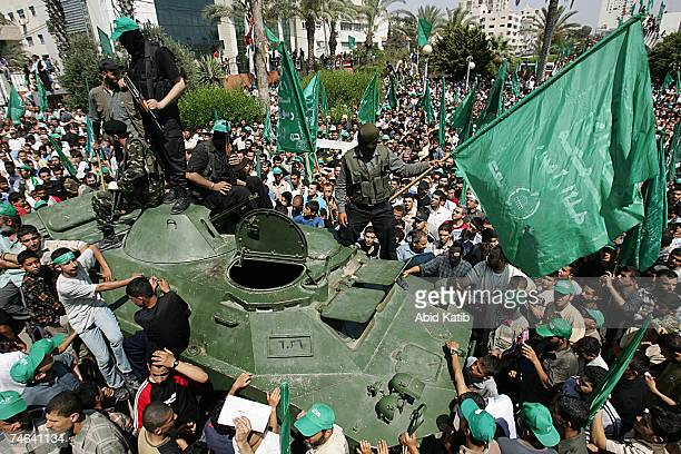 Palestinian Hamas members ride an armored vehicle siezed from Fatah during a celebration rally June 15 2007 in Gaza City Gaza Strip After Hamas...
