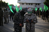Palestinian Hamas militants take part in a rally in support of Palestinian prisoners being held in Israeli jails in Gaza City on April 16 2016
