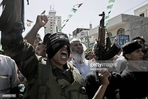 Palestinian Hamas militants take part in an antiIsraeli protest after the weekly Friday prayers in the southern Gaza Strip town of Khan Yunis on...