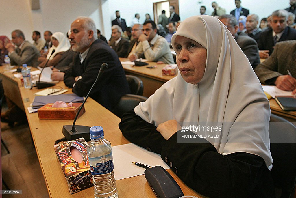 Palestinian Hamas MP Mariam Farhat (R) attends a parliamentary meeting in Gaza City 28 March 2006. The Islamist movement Hamas was set to win parliamentary approval today for its first government after incoming Palestinian premier Ismail Haniya unveiled his political programme with a call for talks with key players in the Middle East peace process. AFP PHOTO/MOHAMMED ABED