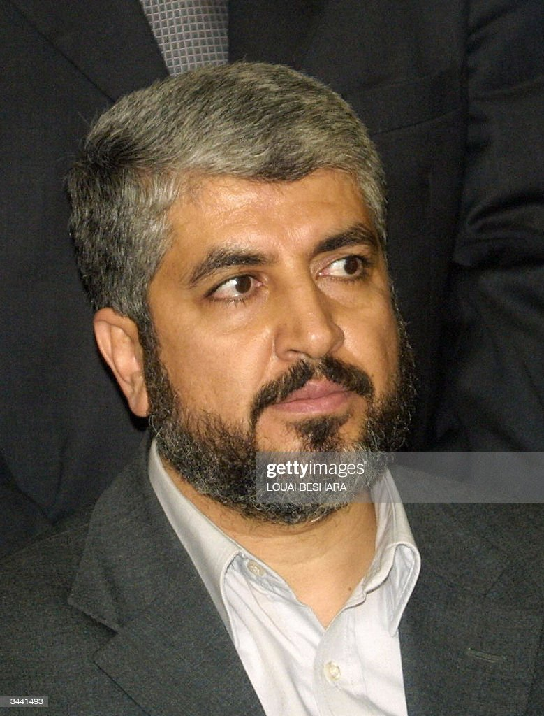 -Palestinian Hamas official Khaled Meshaal looks on during the last day of official mourning for assassinated Hamas spiritual leader Sheikh Yassin killed 22 March 2004. Succeeding Sheikh Ahmed Yassin, firebrand Abdelaziz Rantissi became late 23 March 2004 head of the movement in the Palestinian territories, while Khaled Meshaal retained his position as the head of the organisation's political bureau in Damascus. Israeli military radio reported Israeli cabinet minister Gideon Ezra saying 18 April 2004, that Hamas' Damascus-based political bureau chief Khalid Meshaal would meet 'an identical' fate to the movement's assassinated leader in the Palestinian territories, Abdelaziz Rantissi, killed last night in Gaza City. AFP PHOTO/Louai BESHARA