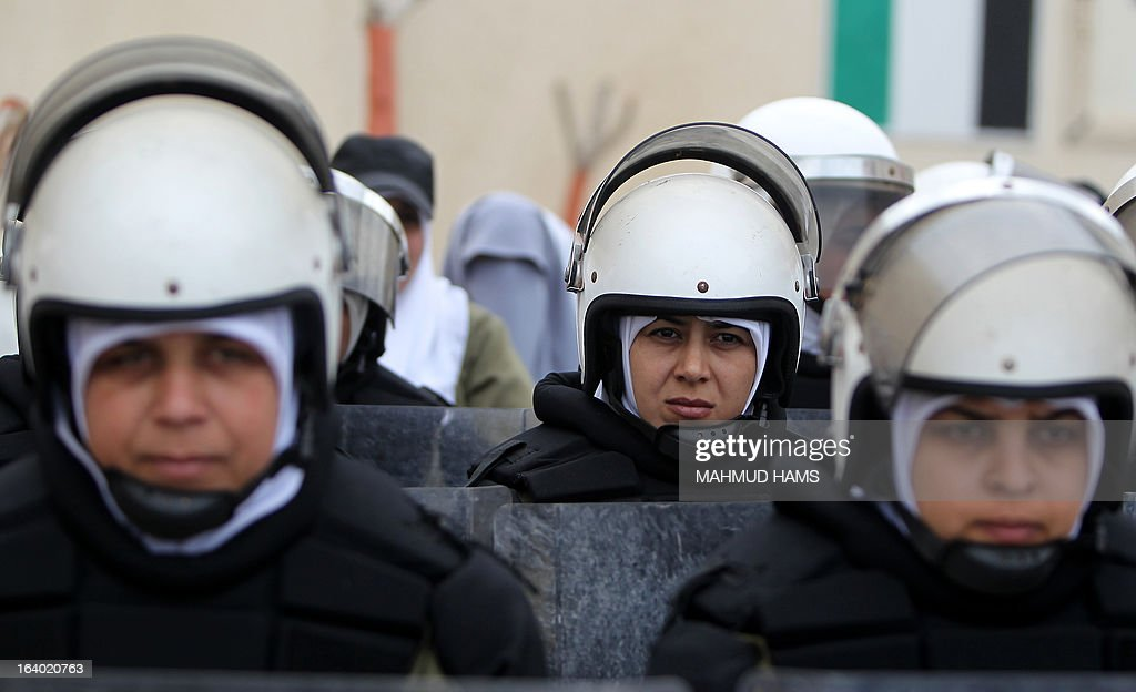 Palestinian Hamas riot policewomen attend their graduation ceremony in Gaza City on March 19, 2013.