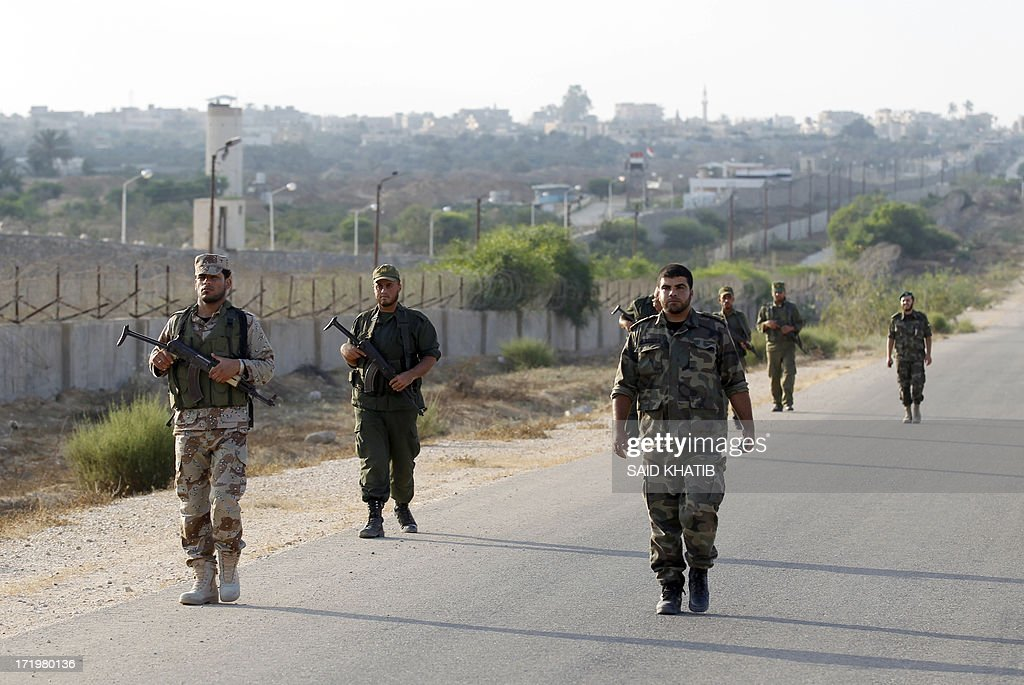 Palestinian Hamas security forces patrol on foot the Rafah area in the Gaza Strip on the border with Egypt on June 30, 2013. Hamas security forces boosted its security presence along the border between the Gaza Strip and Egypt as Egypt prepares for massive demonstrations organized by opponents of President Mohamed Morsi, demanding his 'departure' on the first anniversary of the coming to power.