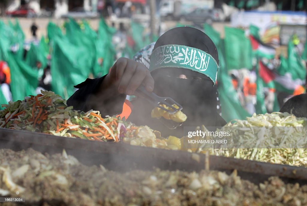 A Palestinian Hamas supporter buys food during a Hamas rally to celebrate the opening of a memorial center in the building that used to house an Israeli prison during its occupation of Gaza, on April 11, 2013, in Gaza City. Israel has evacuated its settlements and army posts in the Gaza Strip in 2005 .