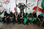 Palestinian Hamas supporters attend the funeral of militants killed during fire exchange against Israeli forces the previous day in the central Gaza...