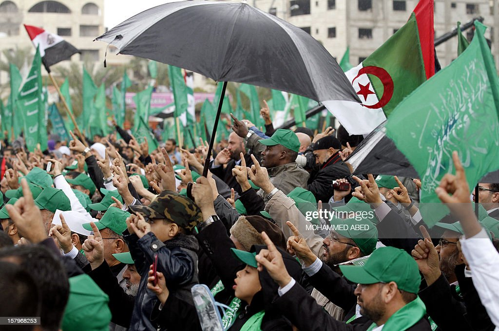 Palestinian Hamas supporters shout slogans as they attend a rally to mark the 25th anniversary of the founding of the Islamist movement, in Gaza City on December 8, 2012. More than 100,000 Palestinians gathered in Gaza for the rally to celebrate the occasion during which Hamas leader in exile Khaled Meshaal delivered a speech. AFP PHOTO/ MOHAMMED ABED