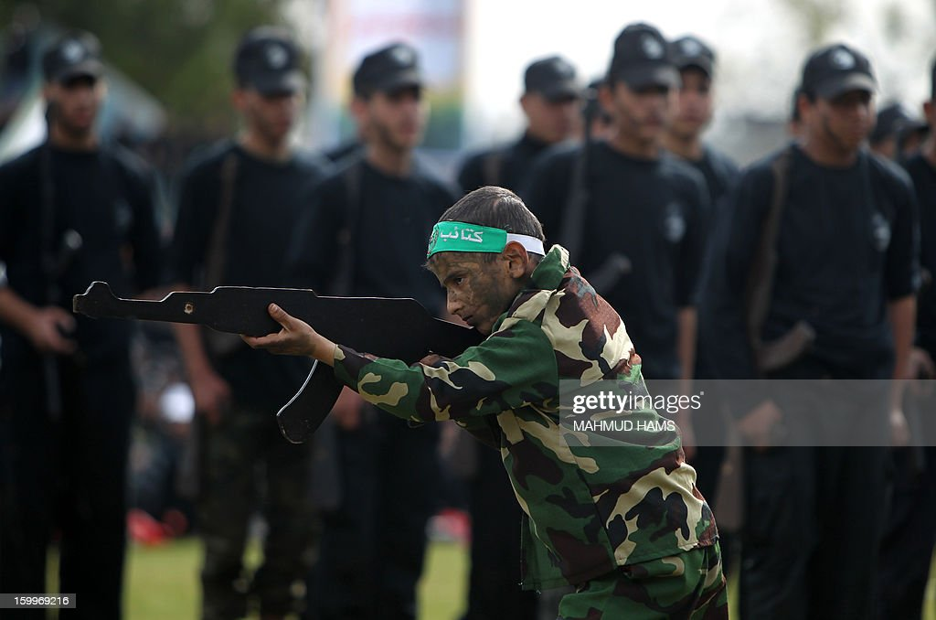 Palestinian high-school students show off their skills during a graduation ceremony from a military school course organised by the Hamas security forces and the Hamas Minister of Education on January 24, 2013 in Gaza City.