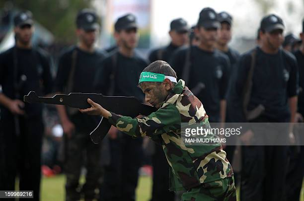 Palestinian highschool students show off their skills during a graduation ceremony from a military school course organised by the Hamas security...