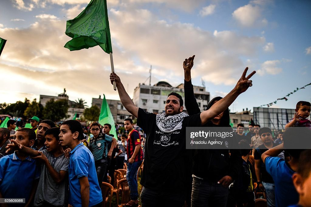 A Palestinian holds flag as Hamas Political Bureau Vice President Ismail Haniyeh speaks during a festival in Gaza City, Gaza on April 28, 2016.