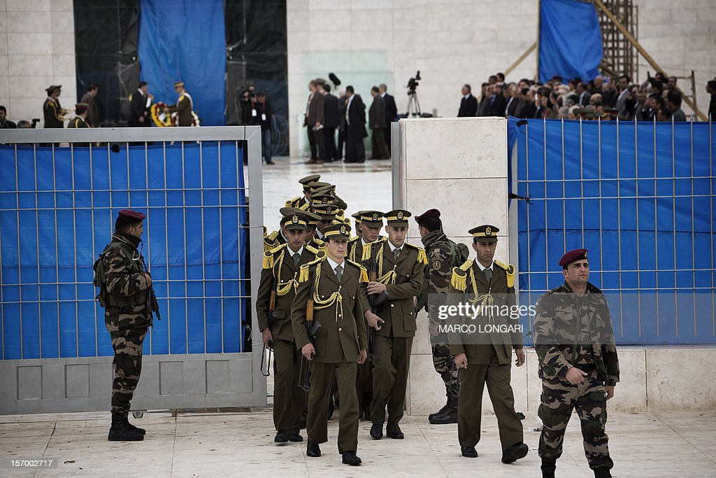 Palestinian honour guards leave the mausoleum of the late Palestinian leader Yasser Arafat after a funeral ceremony on November 27 at the Muqataa in...