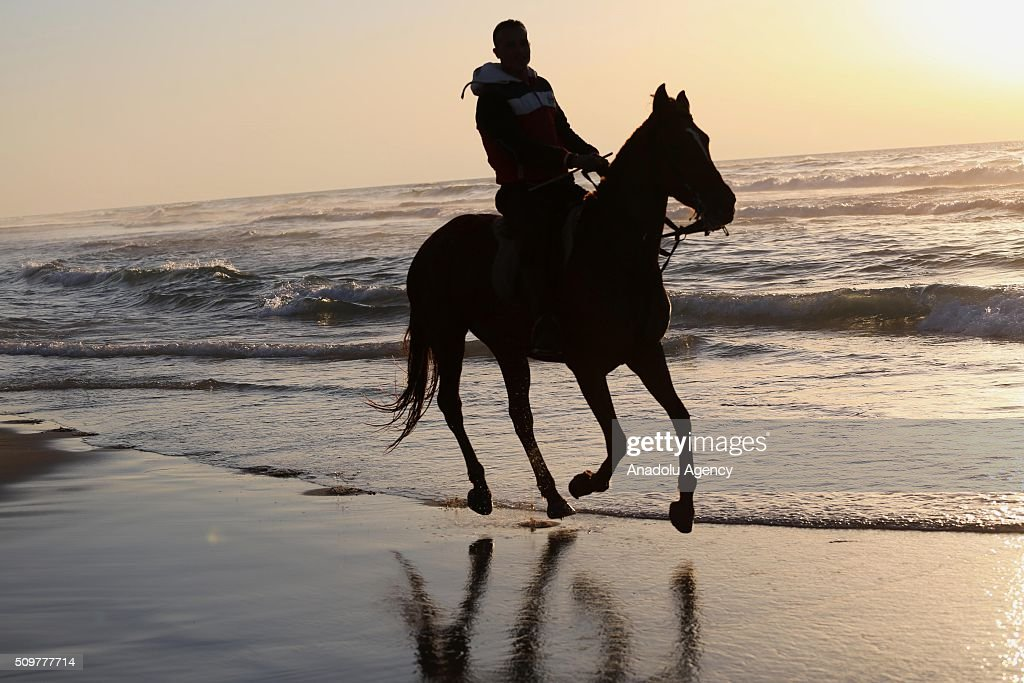 A Palestinian horseback rider rides his horse on Gaza beach as the weather gets better in Gaza City, Gaza on February 12, 2016.