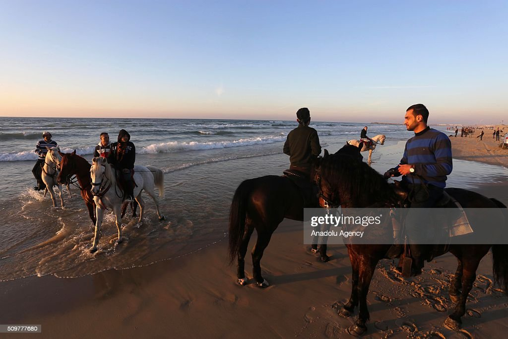 Palestinian horseback riders ride their horses on Gaza beach as the weather gets better in Gaza City, Gaza on February 12, 2016.