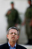 Palestinian Information Minister Mustafa Barghouti speaks to the media after a meeting with Palestinian President Mahmoud Abbas in Abbas's Muqata...