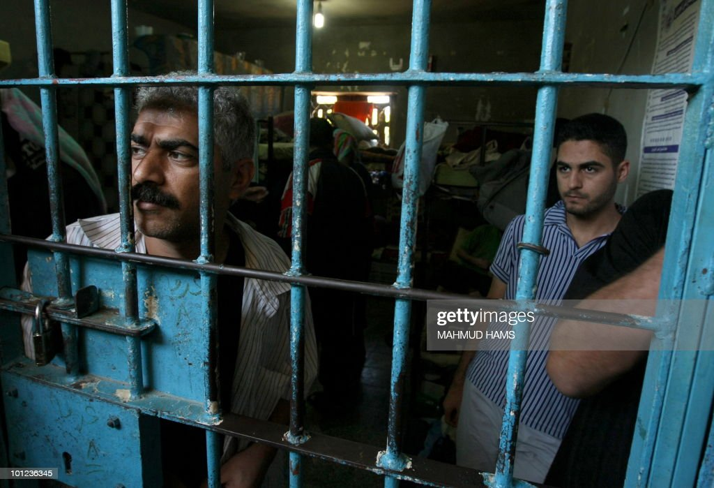 Palestinian inmates stand in a cell at a prison controlled by the Hamas police in Gaza City on May 04, 2010. The detention facility was opened after Gaza's main prison was destroyed during Israel�s 22-day military offensive last winter. According to Hamas police, 350 prisoners accused of spying for the Israeli intelligence and a number of other defendants in the transfer of information to the Palestinian Authority in Ramallah and other criminal charges and drug trafficking are jailed in the Gaza Strip.